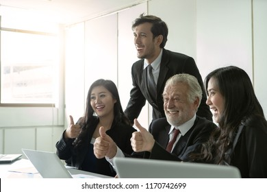Group of business people various nationality glad and cheerful for their successful work. Work with laptop at the modern office with feeling happy and enjoy with achievement project.