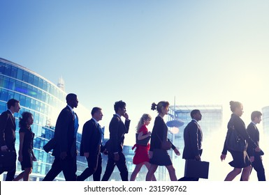 Group of Business People Walking Back Lit Concept