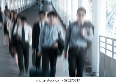 Group of business people walking on the way to airport,business trip. Motion blur.