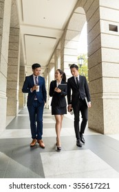 Group of business people walking outside office