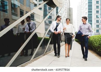 Group of business people walking talking.