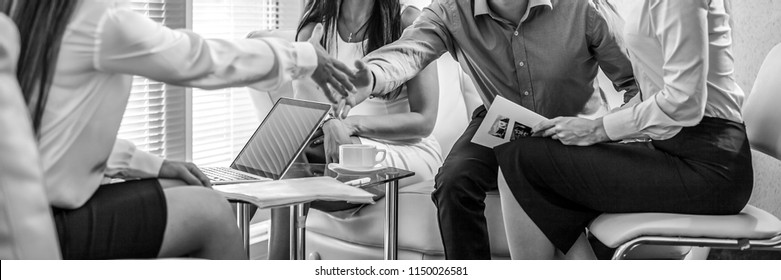 Group of business people at work black-white photo. Employers hands close-up.