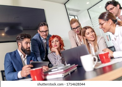 Group of business people working and communicating while sitting at the office together