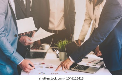 Group of Business people Working Concept. Business team brainstorming. Marketing plan researching. Paperwork on the table, laptop and mobile phone.