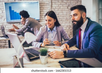 Group of business people working in office and discussing new ideas