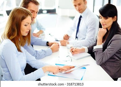 Group of business people working at office on digital tablet
