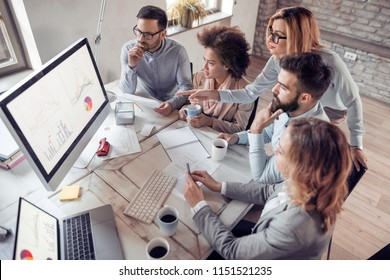 Group of business people working on business project at the table in a modern office.