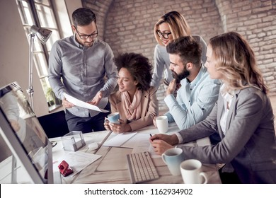 Group of business people working on business project in modern office.