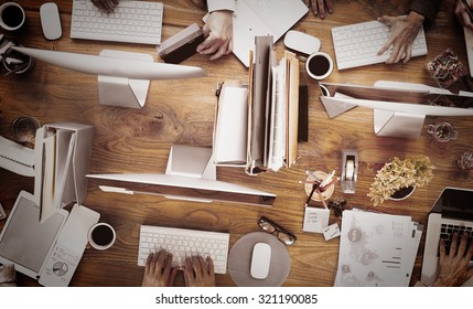 Group of Business People Working on an Office Desk Concept