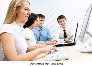 Group of business people working on computer