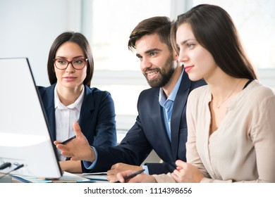 Group of business people working together in a modern office
