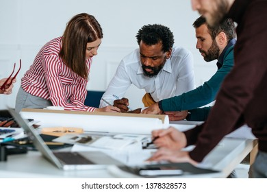 Group of business people working together in the modern office space.