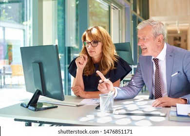 Group of business people working together while sitting in the office in front of computer and analyzing datas. Teamwork.