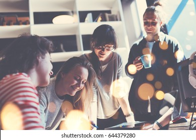 Group of business people working together in big loft office. Marketing department discussing new product plan. Intentional lens flares