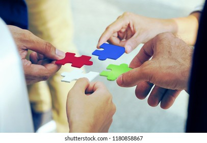 Group of business team assembling jigsaw puzzle, business concept.