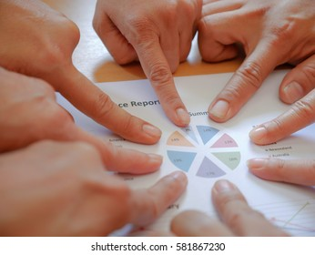 Group of business teamwork point finger to the business report. Concept of business succession.