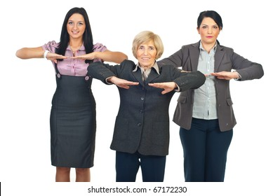 Group of business women doing fitness before starting their work isolated on white background