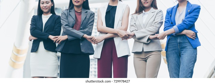 Group of business women holding hands. Woman unite network to help her business with professional connection. Coordinating of business unity to succeed business, cooperation and teamwork businesswome