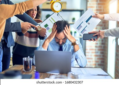 Group of business workers working together. Partners stressing one of them at the office