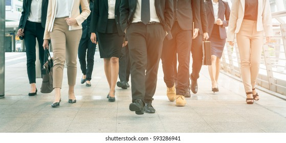 Group of businessman and businesswoman walking in modern city, successful business team.