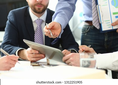 Group businessman are looking and studying statistics on tablet display closeup. Male hand opponent holds pen and points out problem collaboration business coach cooperation partnership palm concept