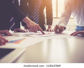 Group of businessman meeting analyze the company performance and growth corporate with information data paper.