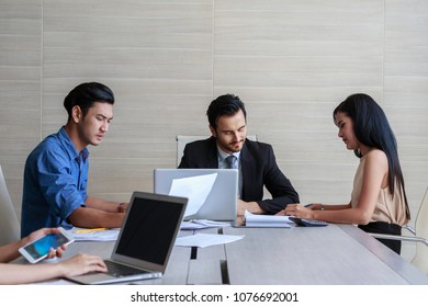 Group of businessman and woman meeting in the office serious.