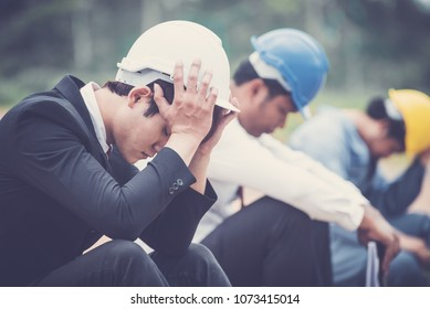 Group of Businessman/Engineering/ Architect Feeling exhausted is working on pressure, Sad dismissed men sitting outside the office after being laid off.