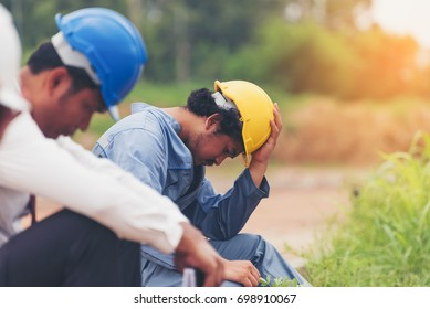 Group of Businessman/Engineering/ Architect Feeling exhausted is working on pressure, while wearing protective equipment safety helmet at construction site,  stressed business concept.