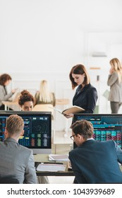 Group of businessmen and businesswomen stock brokers working at office,