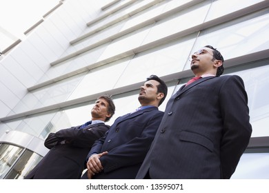 Group of businessmen outside modern office building