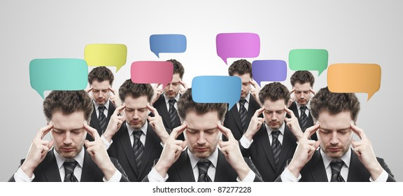 Group of businessmen with social chat sign and speech bubbles. Thinking men representing a social network. Conceptual image of a open minded men.On a gray background