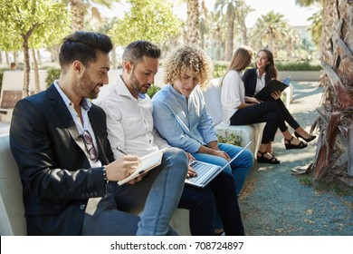 Group of businessmen working outside together