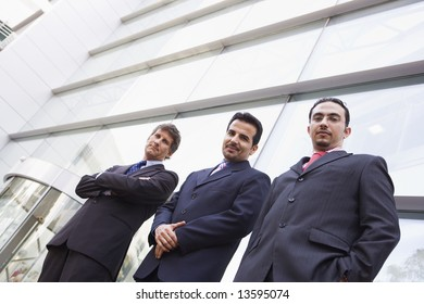 Group of businessment outside modern office building