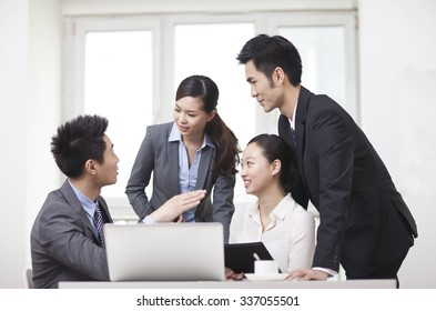 Group of businesspeople discussing in office