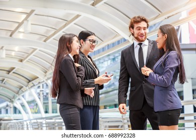Group of businesspeople discussing on a project outside in modern city