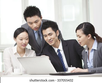 Group of businesspeople discussing,working on computer