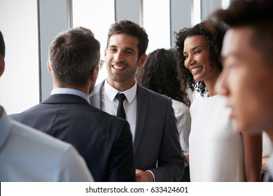 Group Of Businesspeople Having Informal Office Meeting
