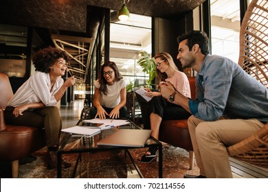Group of businesspeople having a meeting in a modern office. Business team having conversation over new project.