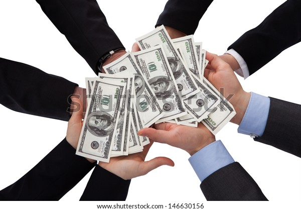 Group Of Businesspeople Holding Banknote Over White Background