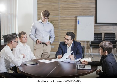 group of businesspeople interacting at meeting
