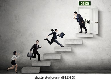 Group of businesspeople running on the stair and compete to enter the office