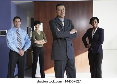 Group of businesspeople smiling in office