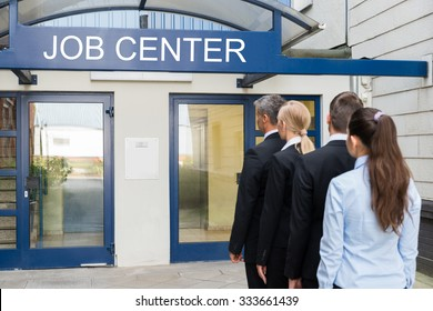 Group Of Businesspeople Standing In Row Outside The Job Center