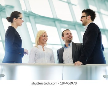 Group of businesspeople standing together in modern office