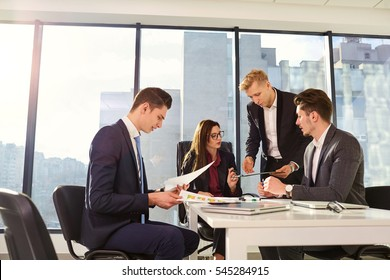 Group of businesspeople working together at a table in the office. Team work.