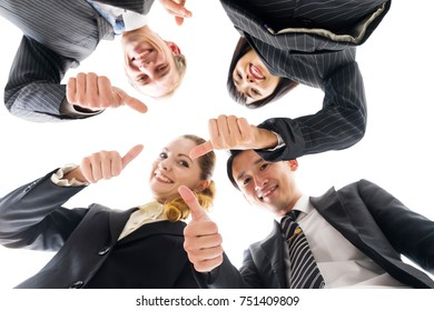 Group of businessperson forming a circle and doing thumb up.