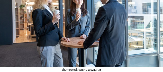 Group of businessperson holding a meeting in the office.