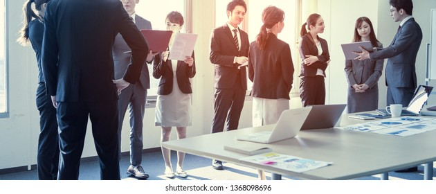 Group of businessperson in meeting room.