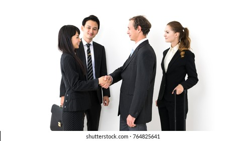 Group of businessperson shaking hands.